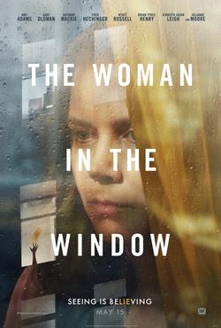 : Kobieta w oknie